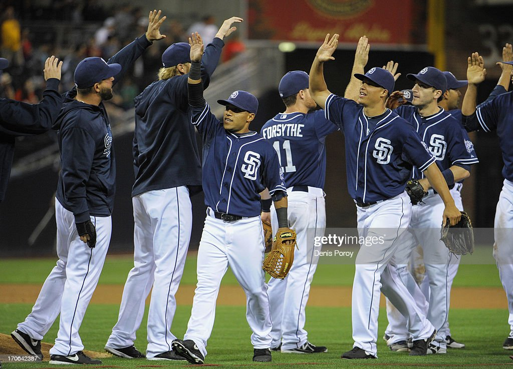 San Diego Padres players high-five after beating the Arizona Diamondbacks 6-4 in a baseball game at Petco Park on June 15, 2013 in San Diego, California.