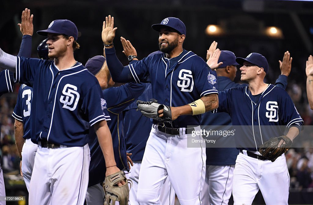 San Diego Padres players high-five after the Padres beat the Colorado Rockies 4-2 in a baseball game at Petco Park May 2, 2015 in San Diego, California.
