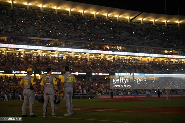 San Diego Padres players stand on the field in the 12th inning when the Los Angeles Dodgers were at bat and the power went out at Dodger Stadium on...