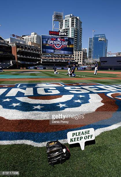San Diego Padres players warm up on the field during batting practice before a baseball game against the Los Angeles Dodgers on opening day at PETCO...