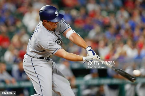 San Diego Padres Right field Hunter Renfroe hits the ball off the end of the bat during the MLB game between the San Diego Padres and Texas Rangers...