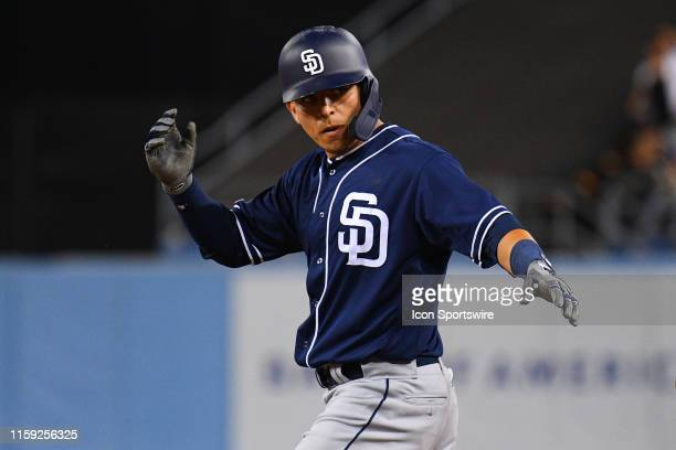 San Diego Padres second baseman Luis Urias celebrates a hit during a MLB game between the San Diego Padres and the Los Angeles Dodgers on August 1...