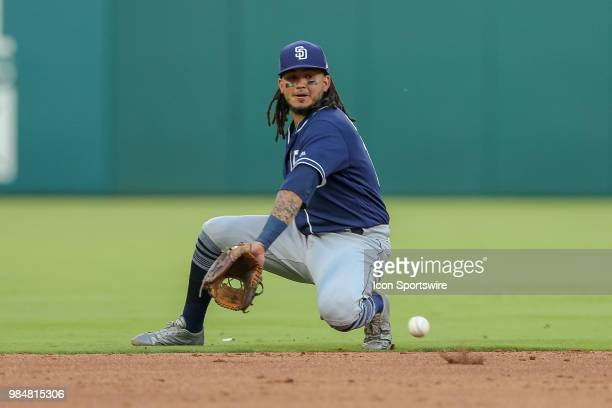 San Diego Padres Shortstop Freddy Galvis attempts to field a hard hit ground ball that turns into a hit during the game between the San Diego Padres...