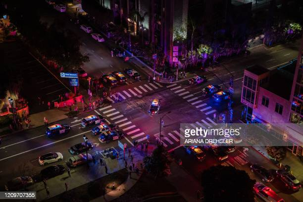 San Diego Police Department and Paramedics gather in downtown San Diego California to show support for the frontline workers and Noel Brandon known...