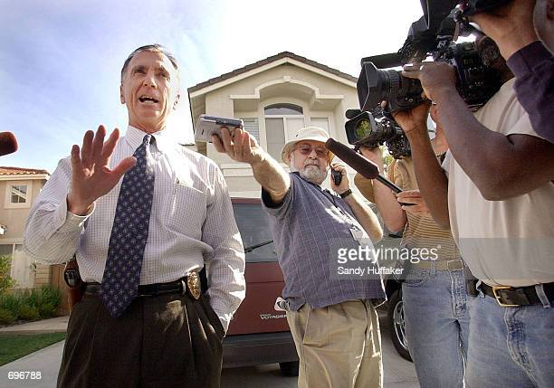 San Diego Police Lt Jim Duncan talks to the news media about the disappearance of Danielle van Dam February 12 2002 in front of her home in Sabre...