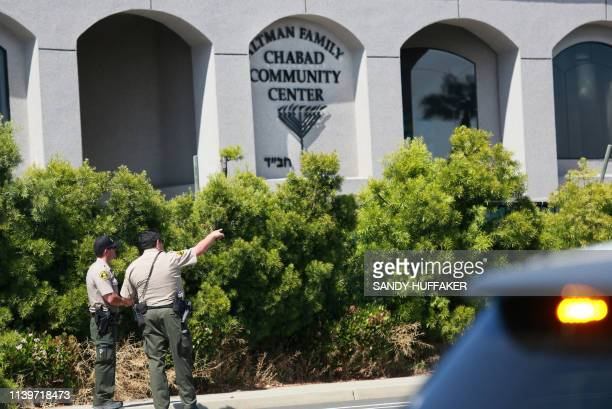 San Diego Sheriff deputies look over the Chabad of Poway Synagogue after a shooting on Saturday April 27 2019 in Poway California A gunman opened...