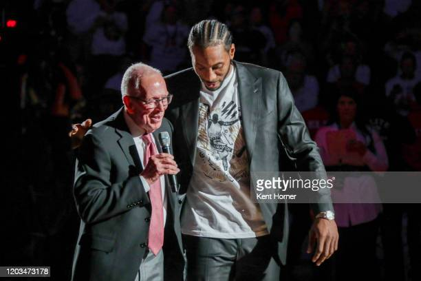 San Diego State Alumni Kawhi Leonard participates in his jersey retirement ceremony with former college coach Steve Fisher during half time of the...