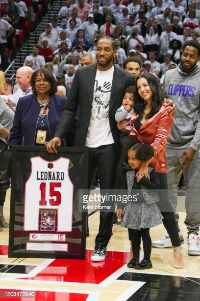 San Diego State Alumni Kawhi Leonard participates with his LA Clippers teammates and family in his jersey retirement ceremony during half time of the...