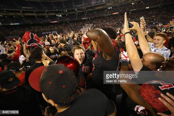 San Diego State Aztecs fans rush the field after the San Diego State Aztecs defeated the Stanford Cardinal 2017 in a game at Qualcomm Stadium on...