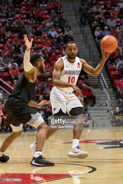 San Diego State University Aztecs guard KJ Feagin keeps the ball away from Grand Canyon Antelopes guard Isiah Brown during the game between the Grand...
