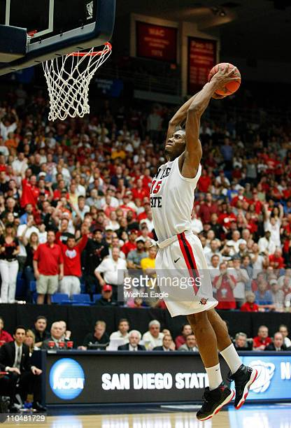 San Diego State's Kawhi Leonard goes up for a dunk to seal victory in a 7164 doubleovertime triumph against Temple in thirdround NCAA tournament...