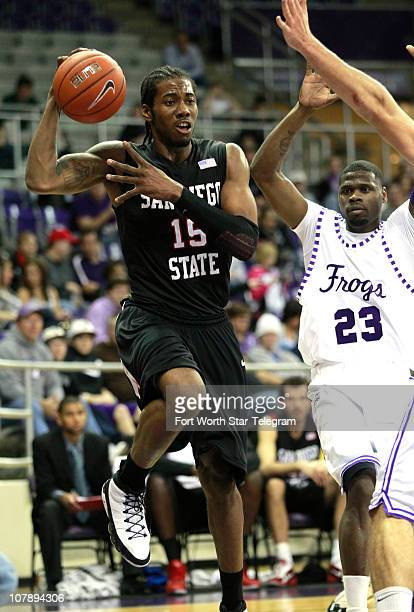 San Diego State's Kawhi Leonard makes a pass from the baseline as Texas Christian's JR Cadot defends at DanielMeyer Coliseum in Fort Worth Texas on...