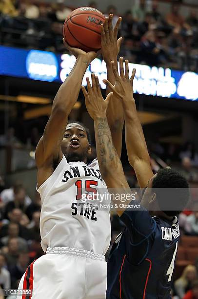 San Diego State's Kawhi Leonard shoots over Connecticut's Jamal CoombsMcDaniel in the first half at the Honda Center in Anaheim California on...