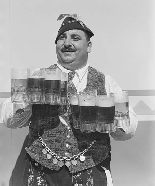 Singing Waiter Balancing Beer