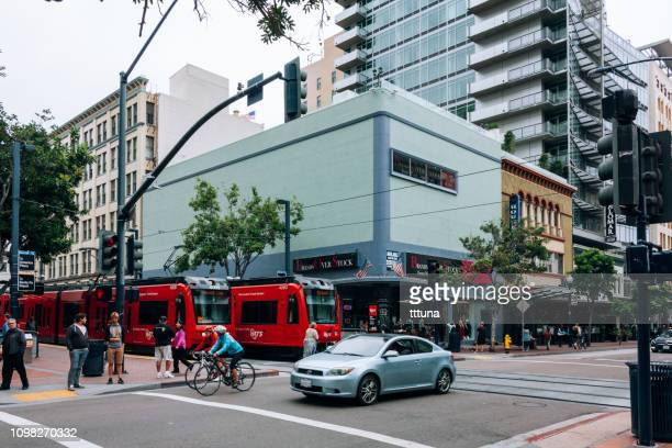 san diego street view, pedestrian walking on crosswalk - train vehicle stock pictures, royalty-free photos & images
