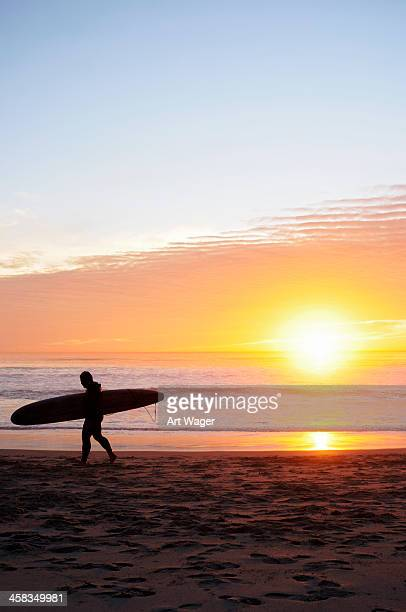 san diego surfer silhouette at sunset - carlsbad california stock pictures, royalty-free photos & images