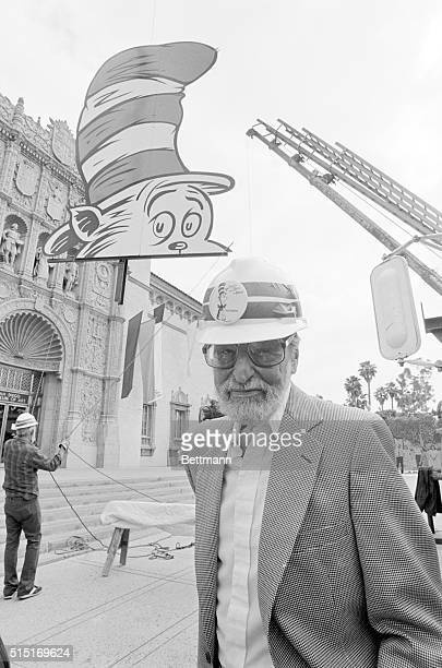 Theodor Seuss Geisel Dr Seuss stands by as workmen raise a giant Cat in the Hat billboard to the roof of the San Diego Museum of Art May 14 kicking...