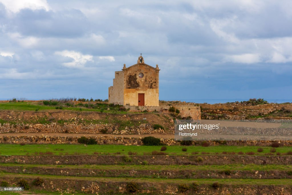 San Dimitri chapel against a cloudy backdrop, Gozo Malta : Stock Photo