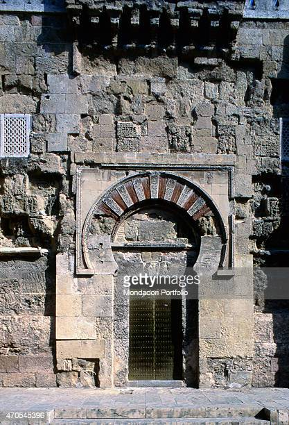 'San Esteban Door by Moorish craftsmen 962987 10th Century marble and sandstone Spain Cordoba Mezquita Whole artwork view Frontal view of the gate of...