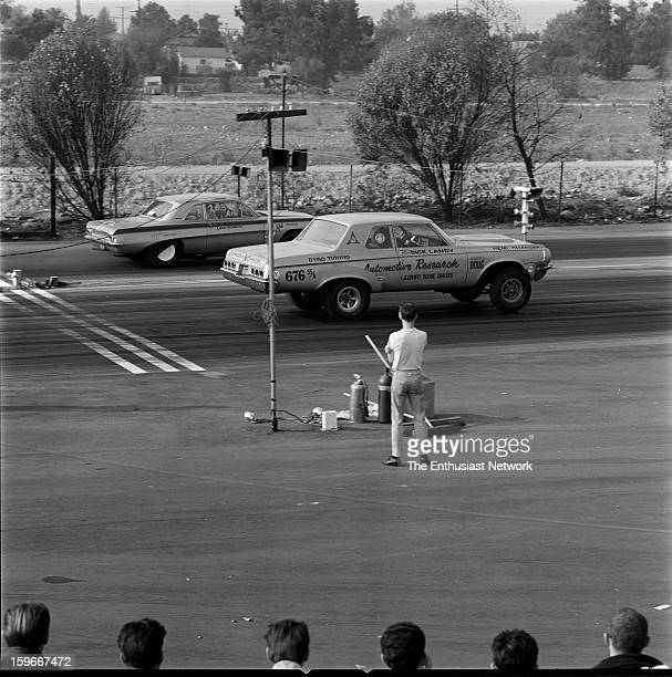 1965 San Fernando Drag Strip Dandy Dick Landy in his 1964 alteredwheelbase Dodge Polara squares off against the Carson Automotive 1961 Pontiac Tempest