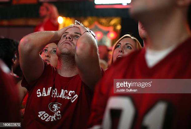San Francisco 49er fans react as they watch Super Bowl XLVII at Ireland's 32 on February 3 2013 in San Francisco California The San Francisco 49ers...