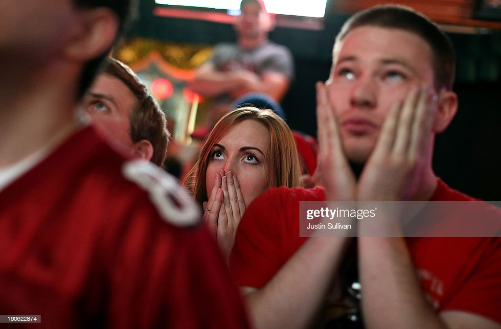 San Francisco 49er fans react as they watch Super Bowl XLVII at Ireland's 32 on February 3, 2013 in San Francisco, California. The San Francisco 49ers are facing off against the Baltimore Ravens in Super Bowl XLVII at the Superdome in New Orleans, Louisana.