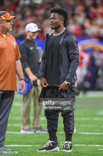San Francisco 49er receiver and Longhorn alumni Marquise Goodwin chats before the Sugar Bowl football game between the Texas Longhorns and Georgia...