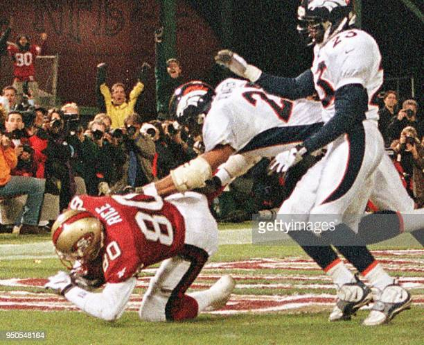 San Francisco 49ers AllPro wide receiver Jerry Rice lands on his left knee in the end zone after catching a second quarter touchdown pass from...