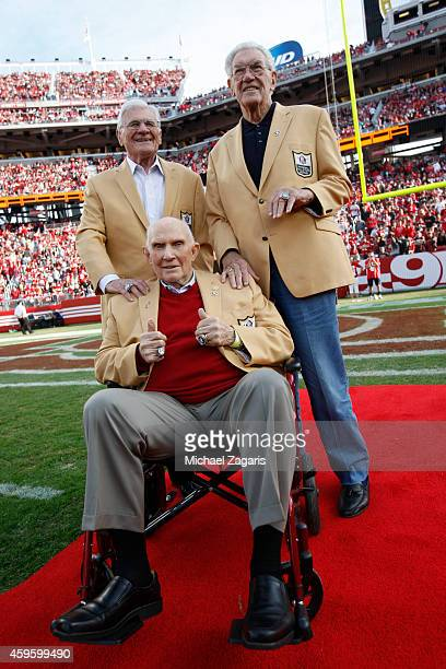 San Francisco 49ers alumni Y A Tittle Bob St Clair and Hugh McElhenny are honored during a halftime ceremony during the game against the Washington...