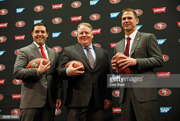 San Francisco 49ers CEO Jed York, Chip Kelly and San Francisco 49ers general manager Trent Baalke pose for a picture after a press conference where...