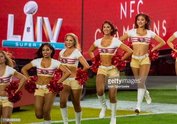 San Francisco 49ers cheerleaders run onto the field before the NFL Super Bowl LIV game between the Kansas City Chiefs and the San Francisco 49ers at...