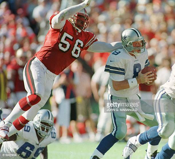 San Francisco 49'ers Chris Doleman sacks Dallas Cowboys quarterback Troy Aikman 02 November in San Francisco Aikman was sacked four times during the...