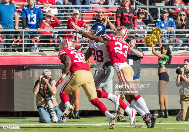 San Francisco 49ers cornerback Ahkello Witherspoon and San Francisco 49ers defensive back Adrian Colbert break up a pass play to New York Giants...