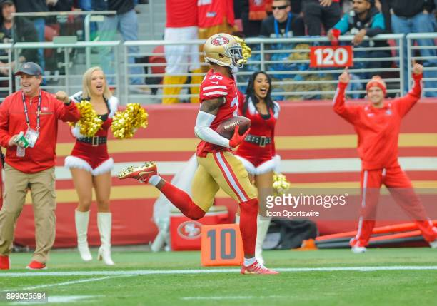 San Francisco 49ers cornerback Dontae Johnson runs the ball down the field after getting a interception during the game between the San Francisco...