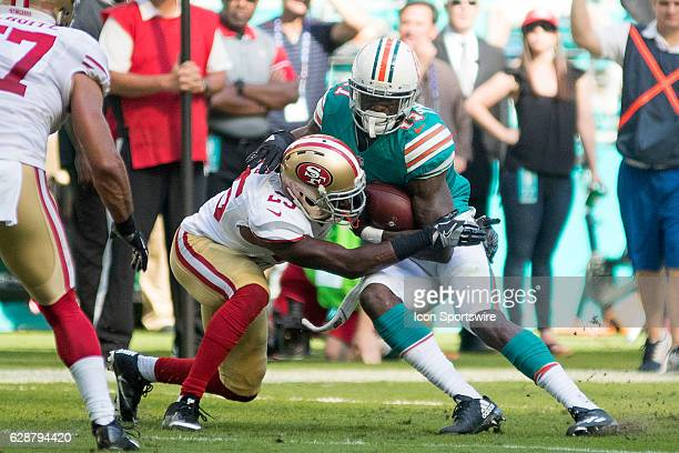 San Francisco 49ers cornerback Jimmie Ward tackles Miami Dolphins wide receiver DeVante Parker during the NFL football game between the San Francisco...