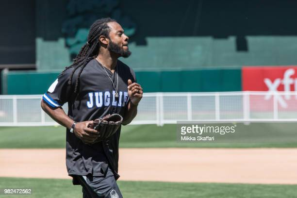 San Francisco 49ers cornerback Richard Sherman plays in Water For Life Charity Softball Game at OaklandAlameda County Coliseum on June 23 2018 in...