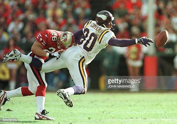 San Francisco 49ers cornerback Rod Woodson breaks up a pass intended for Minnesota Vikings wide receiver Chris Carter in the second quarter of their...