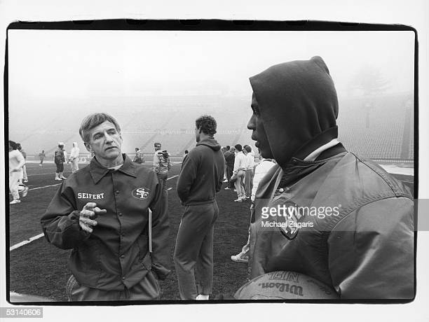 San Francisco 49ers defensive coordinator George Seifert and Keena Turner discuss strategy during practice the day before Super Bowl XIX against the...