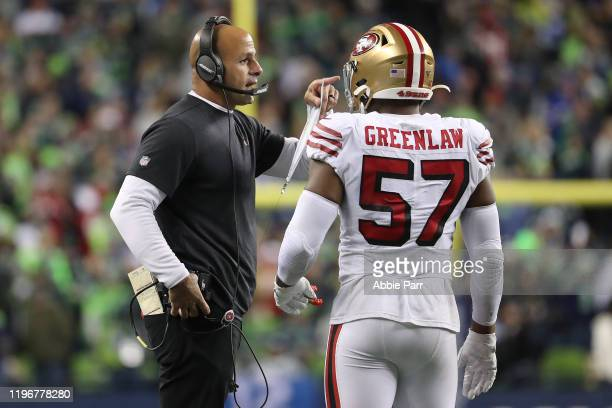 San Francisco 49ers Defensive Coordinator Robert Saleh has a conversation with Dre Greenlaw of the San Francisco 49ers in the fourth quarter against...