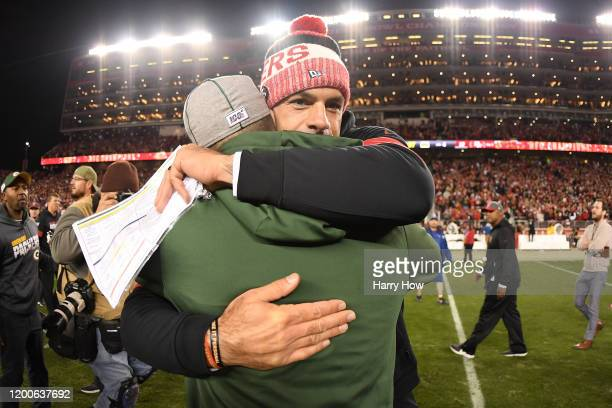 San Francisco 49ers defensive coordinator Robert Saleh hugs head coach Matt LaFleur of the Green Bay Packers following the NFC Championship game at...
