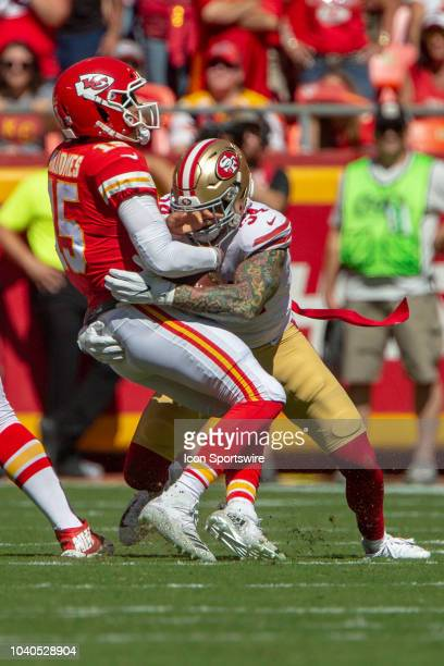 San Francisco 49ers defensive end Cassius Marsh hits Kansas City Chiefs quarterback Patrick Mahomes during the NFL game on September 23 2018 at...