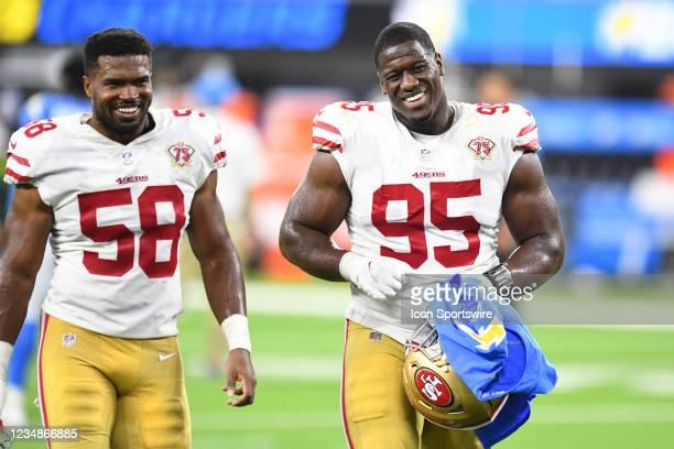 San Francisco 49ers defensive end Kentavius Street and San Francisco 49ers linebacker Justin Hilliard walk off the field after the NFL preseason game...