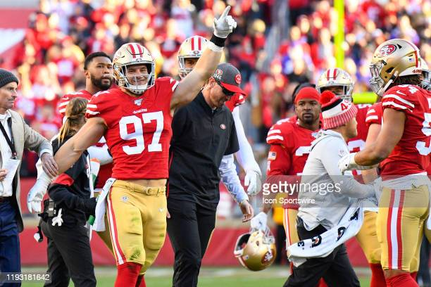 San Francisco 49ers Defensive End Nick Bosa points to the crowd after getting up after being shaken up during the NFC Divisional Playoff game between...