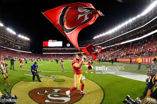 San Francisco 49ers Defensive End Nick Bosa waves the flag after the National Football League game between the Cleveland Browns and the San Francisco...