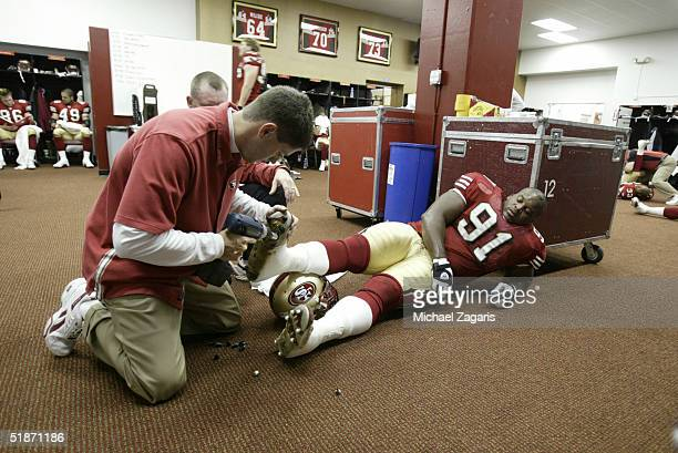 San Francisco 49ers defensive tackle Anthony Adams gets his cleats changed at 3Com Park on 12/7/2003 in San Francisco CA The San Francisco 49ers...