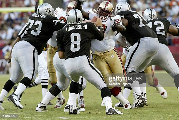 San Francisco 49ers defensive tackle Josh Shaw puts pressure on quarterback Marques Tuiasosopo during a 14 to 10 win over the Oakland Raiders in a...