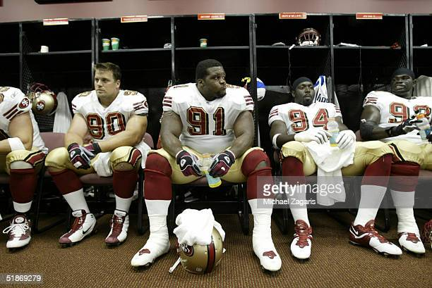 San Francisco 49ers defensive tackles Travis Kirschke Anthony Adams and defensive end Andrew Williams relax in the locker room prior to a 14 to 10...