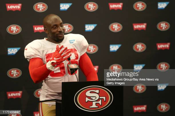 San Francisco 49ers' Elvis Dumervil answers questions from the news media following a joint practice with the Denver Broncos during training camp at...