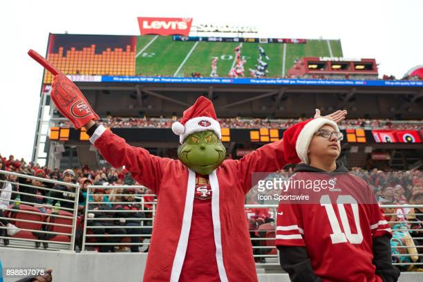 San Francisco 49ers fan celebrates by wearing a Christmas Grinch costume during an NFL game between the Jacksonville Jaguars and the San Francisco...