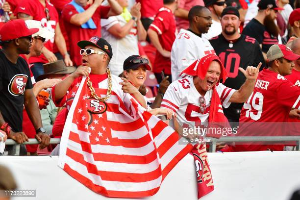 San Francisco 49ers fans cheer during the fourth quarter of a football game against the Tampa Bay Buccaneers at Raymond James Stadium on September...